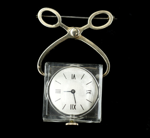 """Item offered is a vintage sterling open back ice cube shaped lapel watch. The watch is set in a clear lucite cube. This watch is attached to a pin. The """"ice cube"""" is accompanied by a sterling ice tong design. The back is marked """"Swiss"""", """"7 Jewels"""", and """"Helbros Watch Co"""".  The numbers are black roman numerals. The watch does work but it runs slow. This can be fixed by switching a needle from the """"s"""" to the """"f"""" on the back of the watch. Condition is good, with some age related wear. Please see photos as they are an extension of our written description."""