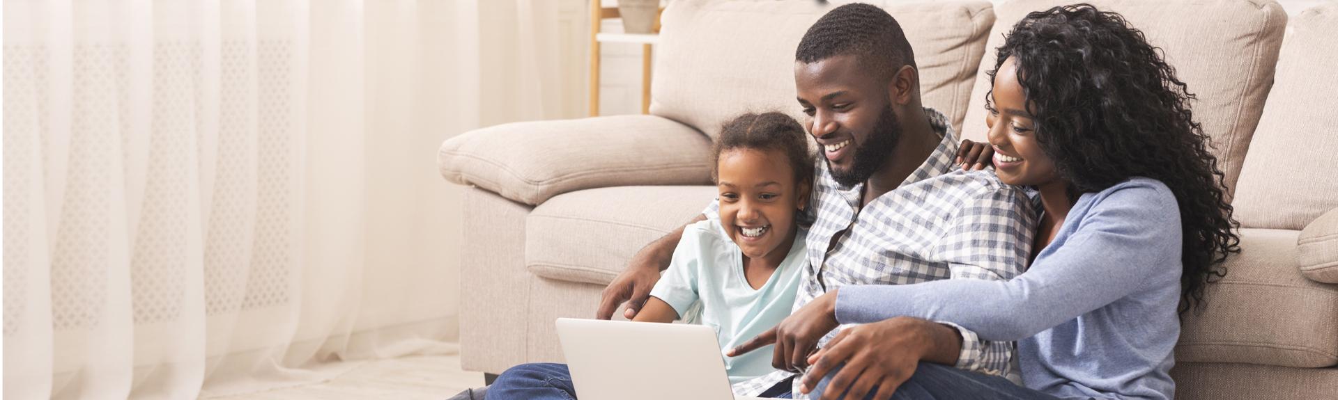 Family looking at computer.