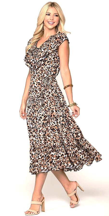 Woman walking in a flowing floral maxi dress smiling and looking back