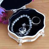Lid and keepsake silver plated box beautifully lined in dark blue.