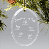 Glass oval Christmas ornament features up to six names of Grandma's love bugs.