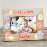 Cute personalized wood frame covered in Easter eggs for baby's first Easter photo.