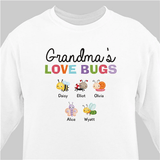 Personalized white sweatshirt crawling with Grandma's Love Bugs.
