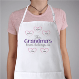 Personalized Apron This Heart Belongs To, in white.