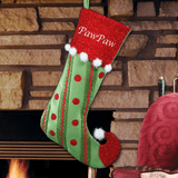 Jester Christmas stocking is red and green, adorned with white pom poms, and embroidered just for Grandpa.