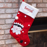 Red and white personalized Christmas stocking with cutest elf and white pom poms.