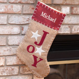 Personalized burlap Christmas stocking is stitched with love and filled with joy.
