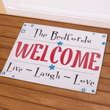 """Personalized Welcome doormat with """"Live - Laugh - Love"""", in red white and  blue."""
