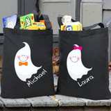 Personalized black canvas trick or treat totes for Halloween, featuring ghosts for girls and boys.