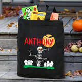 Personalized Halloween black canvas tote features a dancing skeleton.