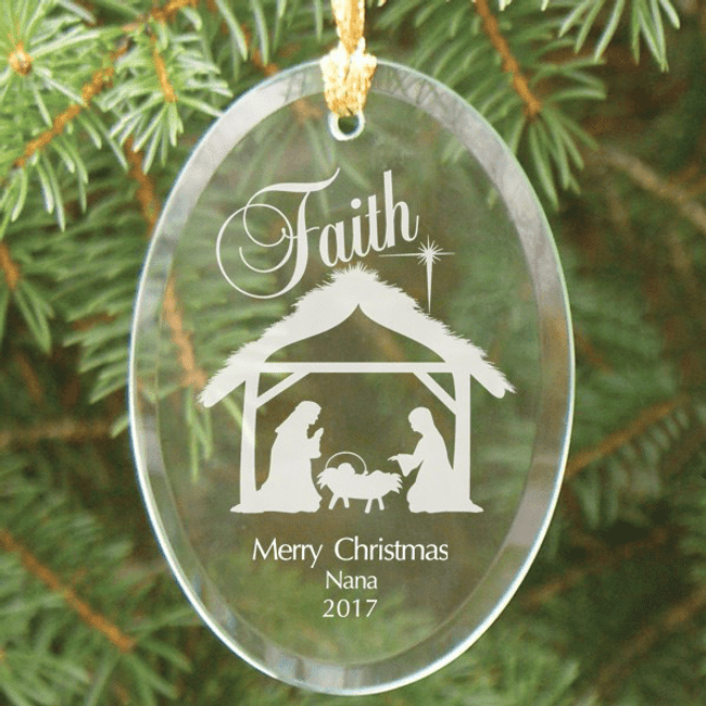 Nativity scene personalized glass ornament has beveled edges, hanging ribbon, and comes in a black velvet pouch.