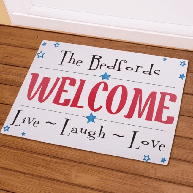 "Personalized Welcome doormat with ""Live - Laugh - Love"", in red white and  blue."