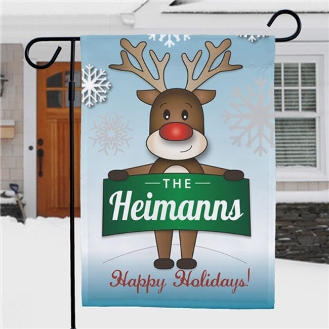 Cute Christmas reindeer garden flag displays a banner with the family name.