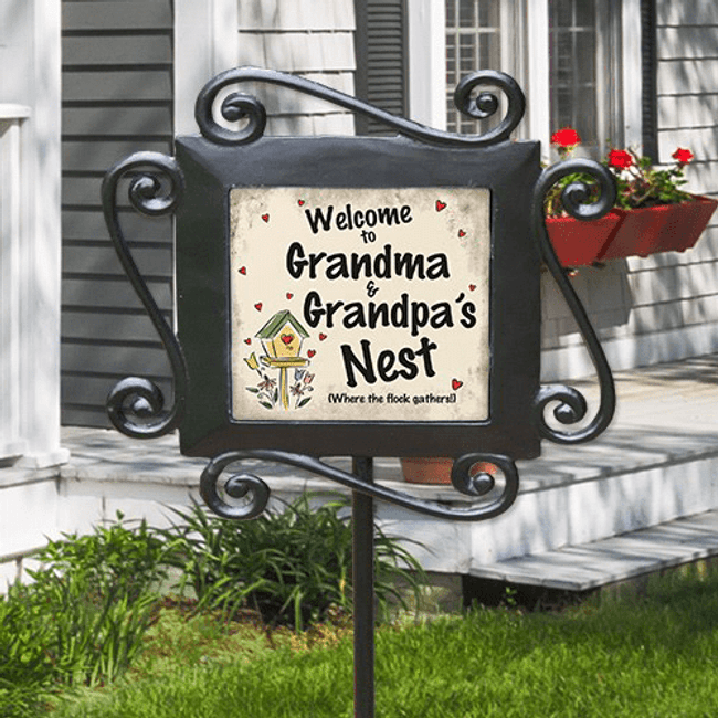 "Wrought iron yard stake personalized on ceramic tile welcomes everyone to your ""nest""."