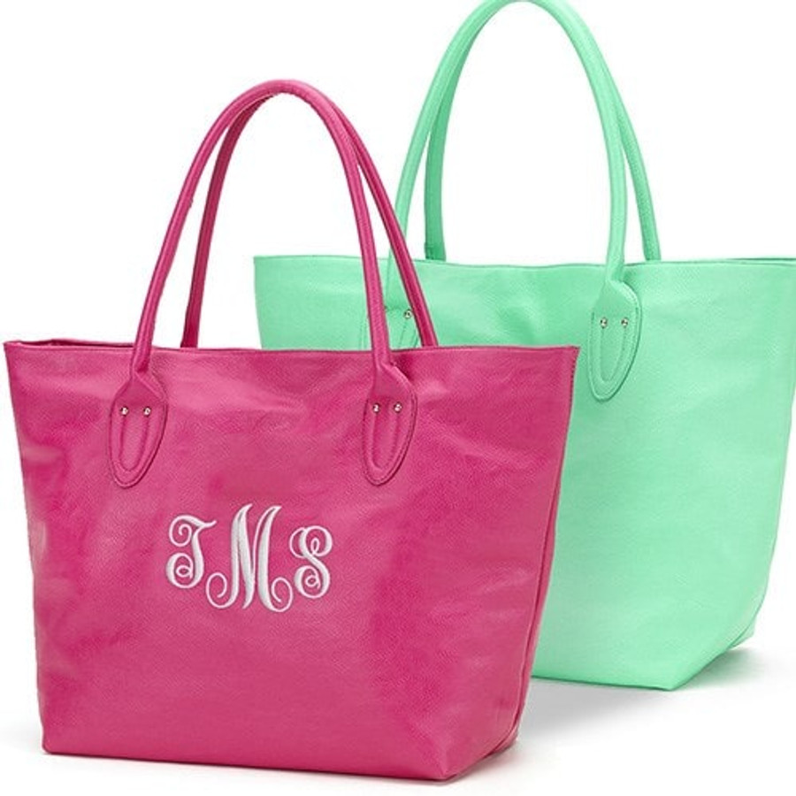 Soft leatherette generous tote embroidered for a special lady, in choice of pink or lime green.