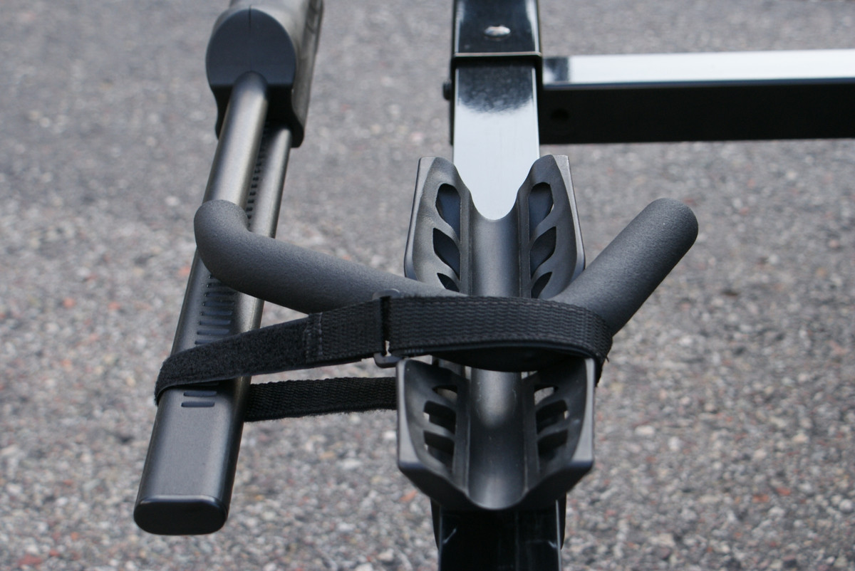 FOR STORAGE OR TRAVEL WITHOUT A BIKE.  REST THE J ARM  INSIDE THE REAR WHEEL SUPPORT, AND SECURE IT WITH THE WEBBING