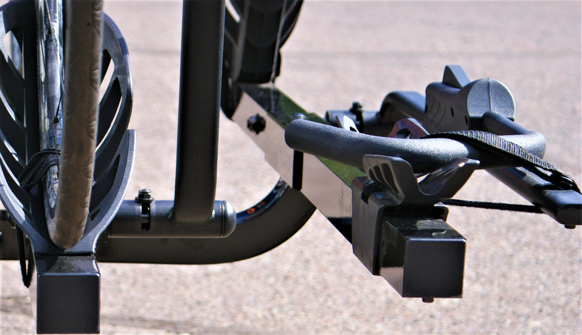 THE PLUS HAS A VERTICAL RISE THAT HELPS TO ELIMINATE BIKE CONTACT, AND HELPS TO KEEP THE RACK FROM SCRAPING