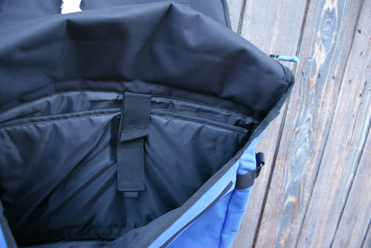 FULLY PADDED COMPUTER POCKET SECURES WITH HOOK/LOOP FASTENER, AND THERE IS AMPLE ROOM FOR LOTS MORE