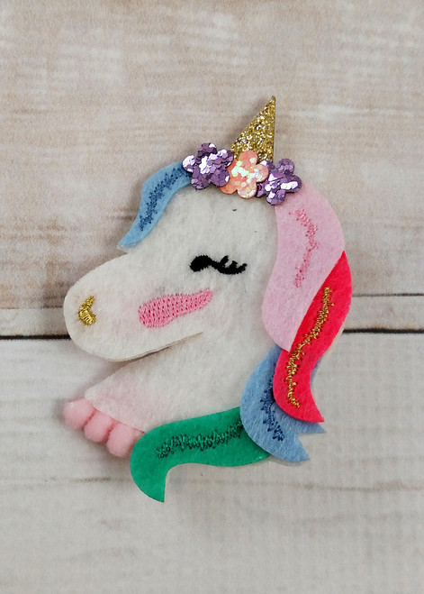 e25d84a541642f Felt unicorn hair clip with glitter accents and alligator clip backing.