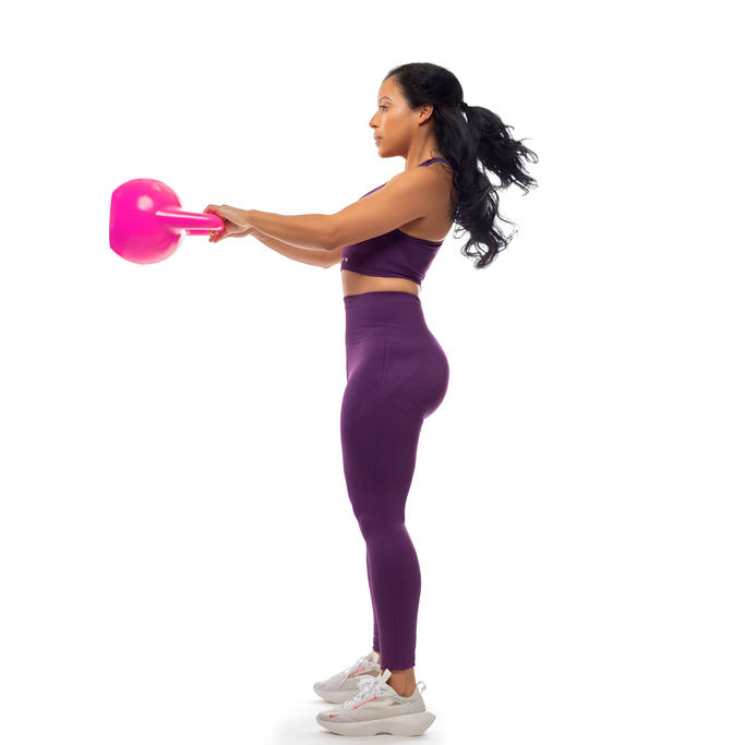 Ana holding kettlebell in front of her
