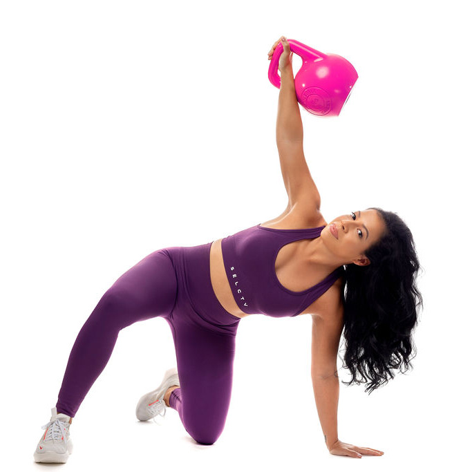 Ana holding pink kettlebell up