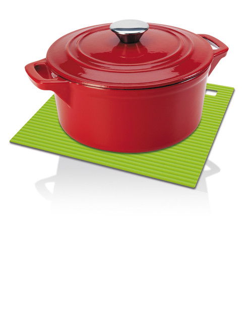 A red, enameled cast iron casserole sitting on a green, ribbed silicone trivet/heat mat