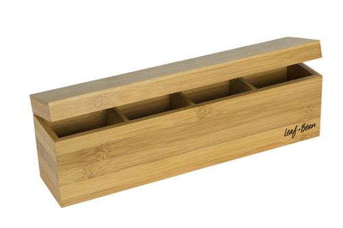 Bamboo box with four compartments. Hinging lid slightly open.