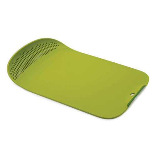 Green rectangular cutting board with a curved perforated lip on the left end.