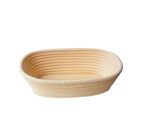 A long, oval basket, with gently sloped sides. Made of woven rattan with a round profile.