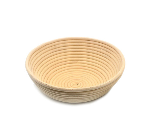 A round basket, with gently sloped sides. Made of woven rattan with a round profile.