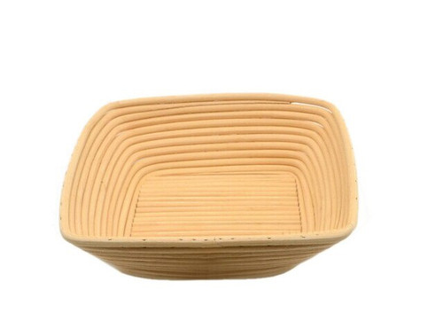 A square basket, with gently sloped sides. Made of woven rattan with a round profile.