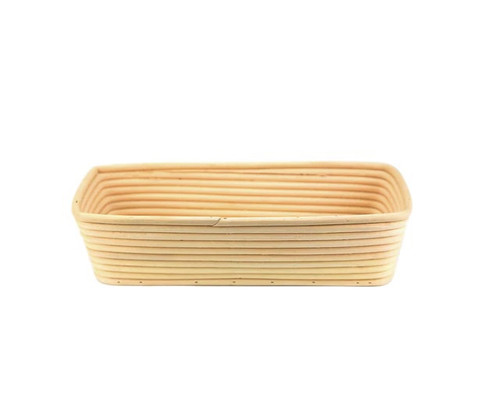 A long rectangular basket, with gently sloped sides. Made of woven rattan with a round profile.