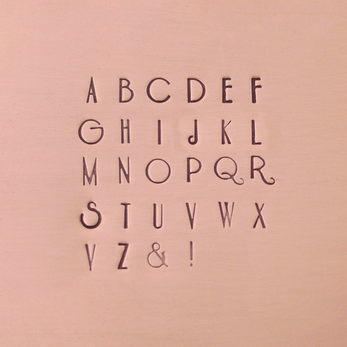 Delphinus Uppercase Stamped Sample