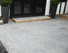 Global Stone Limestone Paving - Midnight. Showing effects of ageing to soft grey