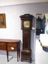 A Scottish long case oak clock