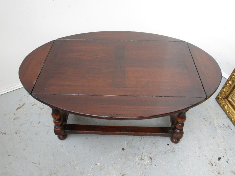Scottish oak coffee table with folding sides