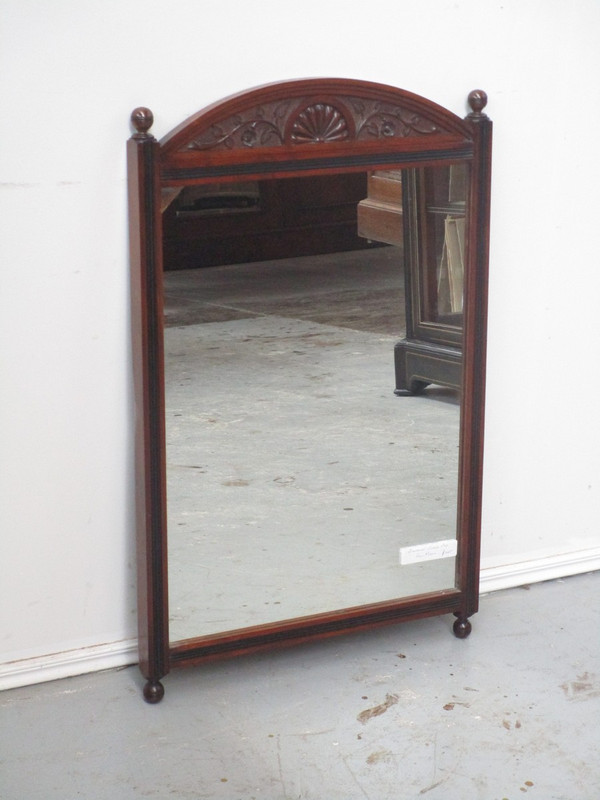 A carved oak wall mirror
