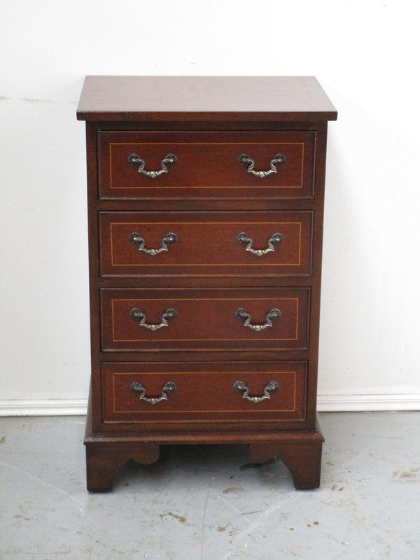 A petite chest of drawers