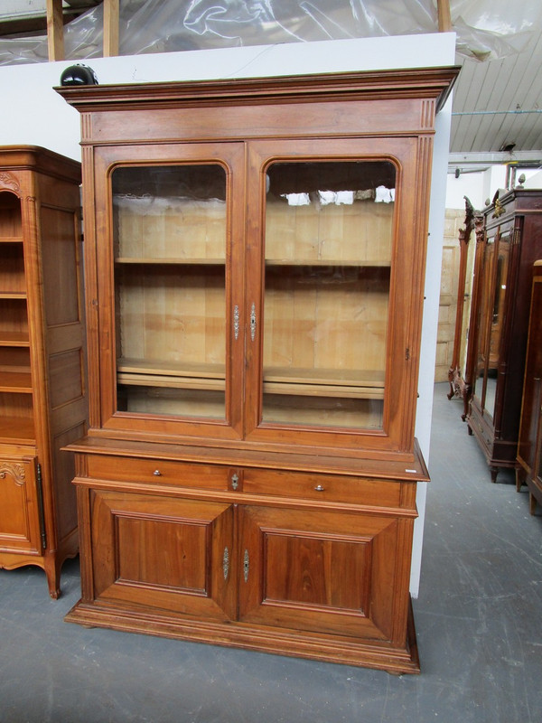 A light walnut French two door bookcase in unrestored condition