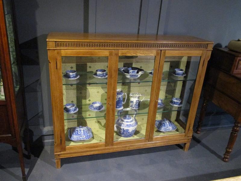 A natural light Oak antique display case