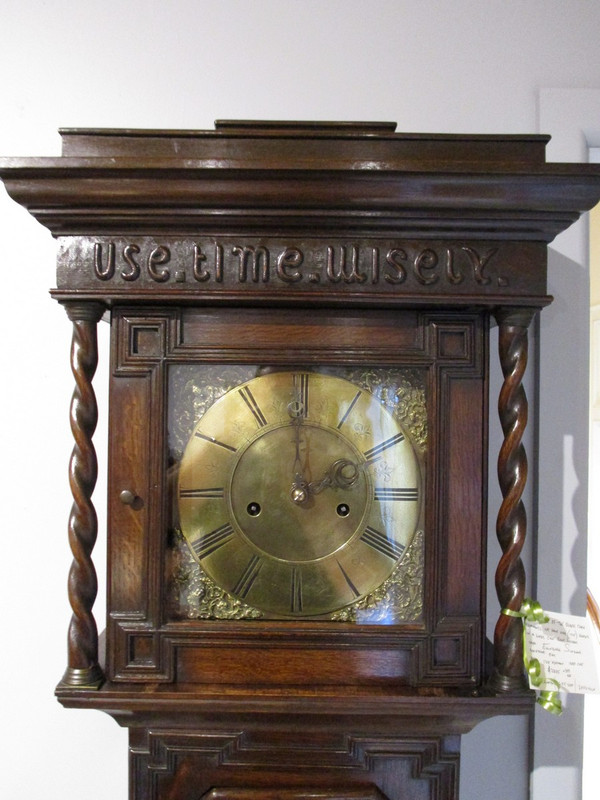 A Scottish long case oak clock