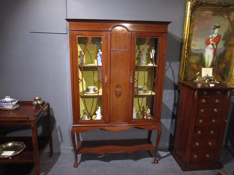 A Sheridan revival antique glass display case