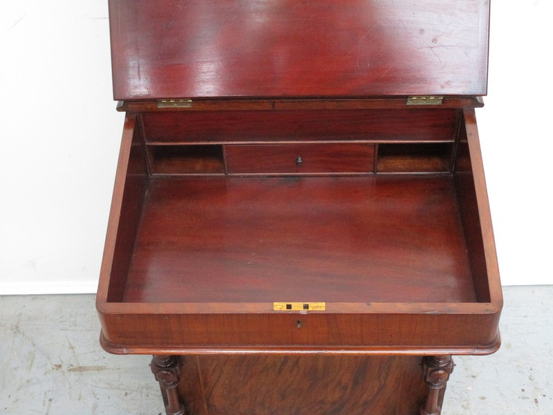 A rosewood inlaid davenport desk