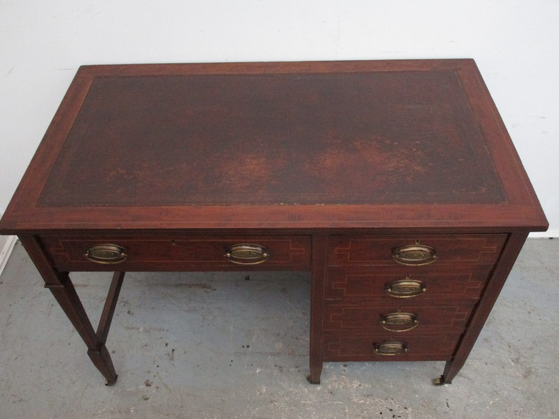 A Sheridan revival leather top desk