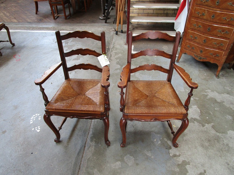A set 6 of rush seated French chairs including two matching carver chairs