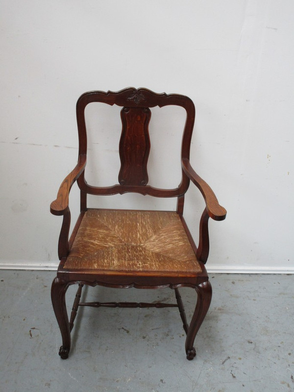 A single French oak rush seated carver chair