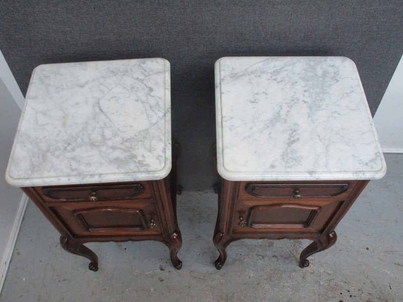 French mahogany bedside cupboards with white marble tops