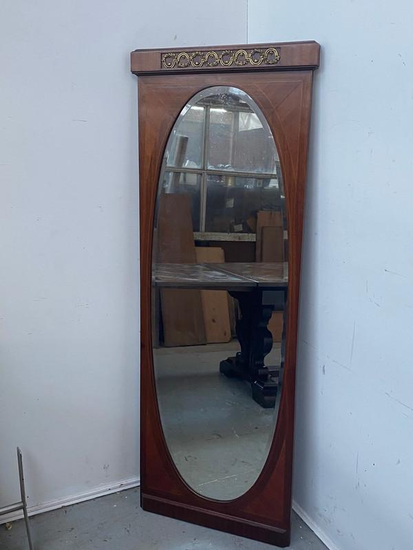 A tall, thin French mahogany mirror