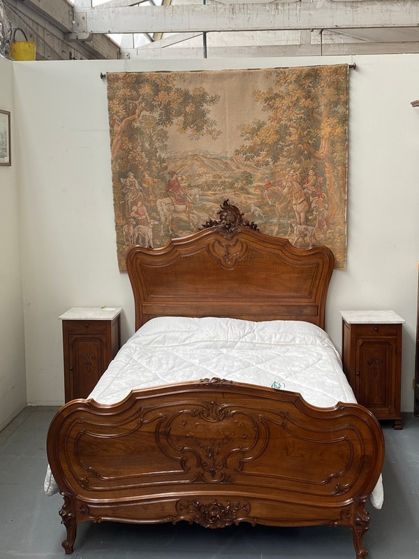 Antique queen size French curved walnut bed