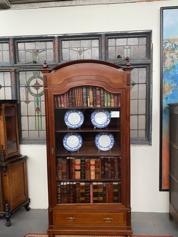 A large mahogany antique French bookcase